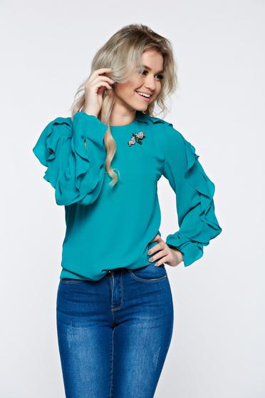 Bluza dama LaDonna turcoaz eleganta din material vaporos accesorizata cu brosa