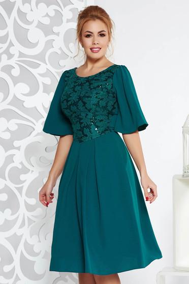 Rochie verde-inchis de ocazie in clos din stofa usor elastica captusita pe interior cu aplicatii cu paiete